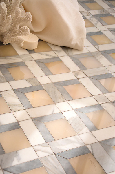 Paseo, a handmade mosaic shown in polished Cream Onyx, honed Allure, and honed Calacatta Tia, is part of the Illusions® collection by Sara Baldwin and Paul Schatz for New Ravenna.