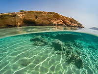 Half underwater view of an exotic beach of Koufonissi island, Greece