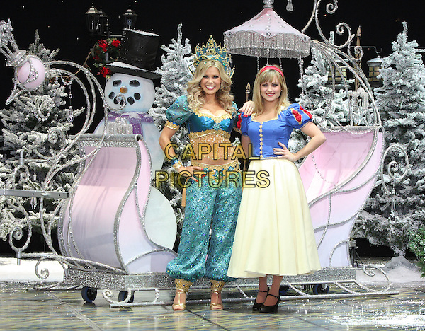 MELINDA MESSENGER & TINA O'BRIEN.First Family Entertainment 2011 Pantomimes Photocall at the Piccadilly Theatre, London, November 26th 2010..panto costume full length genie blue turquoise beaded bra top trousers harem tassels midriff tummy stomach crop cropped snow white sleigh dress hands on hips  .CAP/JIL.©Jill Mayhew/Capital Pictures