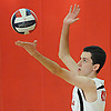 Floral Park No. 4 Brian Rattigan serves during a Nassau County varsity boys' volleyball match against Farmingdale at Floral Park High School on Thursday, September 24, 2015. Floral Park won 23-25, 25-19, 25-15, 25-12.<br /> <br /> James Escher