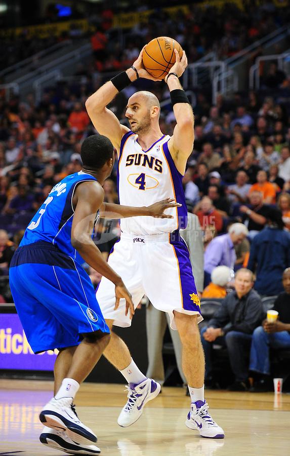 Mar. 27, 2011; Phoenix, AZ, USA; Phoenix Suns forward (4) Marcin Gortat against the Dallas Mavericks at the US Airways Center. The Maverick defeated the Suns 91-83. Mandatory Credit: Mark J. Rebilas-