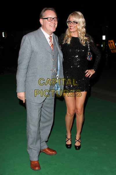 VIC REEVES & NANCY SORRELL.The Specsavers Spectacle Wearer Of The Year 2009 Grand Final at Victoria & Albert Museum, London, England..October 27th, 2009.V&A full length grey gray suit jacket black sequins sequined glasses married husband wife mini hand on hip brown shoes .CAP/AH.©Adam Houghton/Capital Pictures.