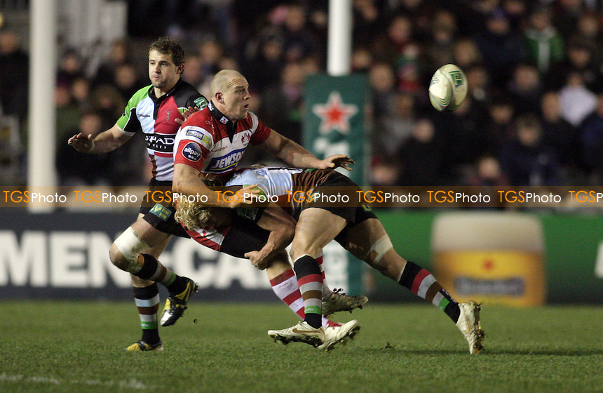 Mike Tindall of Gloucester is flatten by Matt Hopper of Harlequins RFC - Harlequins RFC vs Gloucester RFC - Heineken Cup Pool 6 Rugby at the Twickenham Stoop - 14/01/12 - MANDATORY CREDIT: Helen Watson/TGSPHOTO - Self billing applies where appropriate - 0845 094 6026 - contact@tgsphoto.co.uk - NO UNPAID USE.