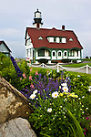 Portland Head Light with colorful flowers in the foreground