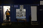 Atherton Collieries 1, Boston United 0, 23/11/19. Alder House, FA Trophy, third qualifying round. An away supporter pictured next to the scoreboard as Atherton Collieries played Boston United in the FA Trophy third qualifying round at the Skuna Stadium. The home club were formed in 1916 and having secured three promotions in five season played in the Northern Premier League premier division. This was the furthest they had progressed in the FA Trophy and defeated their rivals from the National League North by 1-0, Mike Brewster scoring a late winner watched by a crowd of 303 spectators. Photo by Colin McPherson.