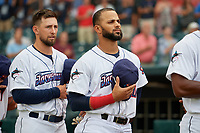 Jacksonville Jumbo Shrimp Cody Poteet (21) and J.C. Millan (20) during the national anthem before a Southern League game against the Mobile BayBears on May 28, 2019 at Baseball Grounds of Jacksonville in Jacksonville, Florida.  Mobile defeated Jacksonville 2-1.  (Mike Janes/Four Seam Images)