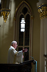 January 24, 2012; President emeritus, Rev. Edward A. Malloy, C.S.C., delivers the homily for the Mass of Remembrance on the 20th anniversary of the University of Notre Dame swimming team bus accident in the Basilica of the Sacred Heart. Photo by Barbara Johnston/University Photographer