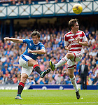 Joey Barton's shot is stopped by Louis Longridge