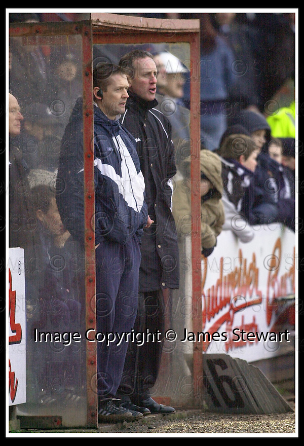 01/02/2003                   Copyright Pic : James Stewart.File Name : stewart-falkirk v st john 15.BILLY DAVIS AND BILLY STARK WATCH FROM THE DUG OUT...James Stewart Photo Agency, 19 Carronlea Drive, Falkirk. FK2 8DN      Vat Reg No. 607 6932 25.Office     : +44 (0)1324 570906     .Mobile  : +44 (0)7721 416997.Fax         :  +44 (0)1324 570906.E-mail  :  jim@jspa.co.uk.If you require further information then contact Jim Stewart on any of the numbers above.........
