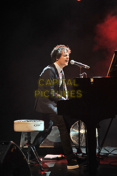 Jamie Cullum.Performing live in concert at The Forum, Kentish Town, London, England..18th October 2011.stage gig performance music in on full length black suit singing piano side profile sitting .CAP/MAR.© Martin Harris/Capital Pictures.