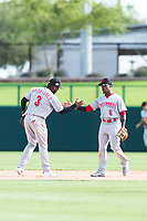 Scottsdale Scorpions infielders Alfredo Rodriguez (3) and Shed Long (6), both of the Cincinnati Reds organization, celebrate a victory after an Arizona Fall League game against the Glendale Desert Dogs at Camelback Ranch on October 16, 2018 in Glendale, Arizona. Scottsdale defeated Glendale 6-1. (Zachary Lucy/Four Seam Images)