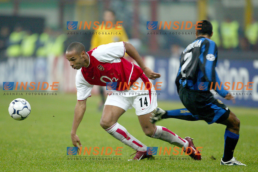 MILANO 25/11/2003 <br /> Champions League Inter Arsenal 1-5<br /> Thierry Henry (Arsenal) Ivan Cordoba (Inter)<br /> Photo Andrea Staccioli Insidefoto