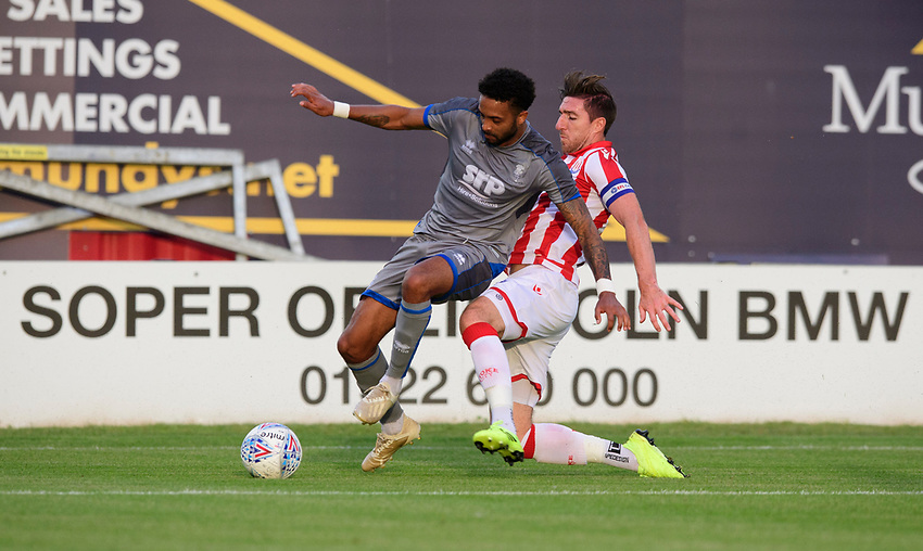 Lincoln City's Bruno Andrade is fouled by Stoke City's Stephen Ward<br /> <br /> Photographer Chris Vaughan/CameraSport<br /> <br /> Football Pre-Season Friendly - Lincoln City v Stoke City - Wednesday July 24th 2019 - Sincil Bank - Lincoln<br /> <br /> World Copyright © 2019 CameraSport. All rights reserved. 43 Linden Ave. Countesthorpe. Leicester. England. LE8 5PG - Tel: +44 (0) 116 277 4147 - admin@camerasport.com - www.camerasport.com