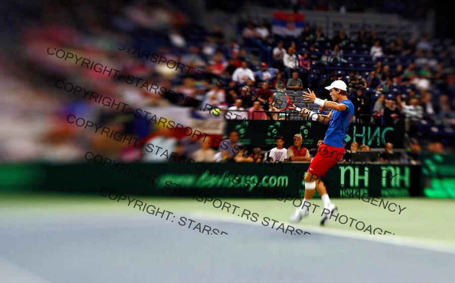 Tomas Berdych of the Czech Republic returns the ball to Novak Djokovic of Serbia during their Davis Cup semi final tennis match, Belgrade, SERBIA, Sunday, September 19, 2010. (credit & photo: Pedja Milosavljevic / +381 64 1260 959 / thepedja@gmail.com)