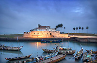 Fishing boats in the lagoon in front of Elmina castle, also known as St. George's castle. The castle, built by the Portuguese in 1482, was at one stage the largest slave trading post in the world.