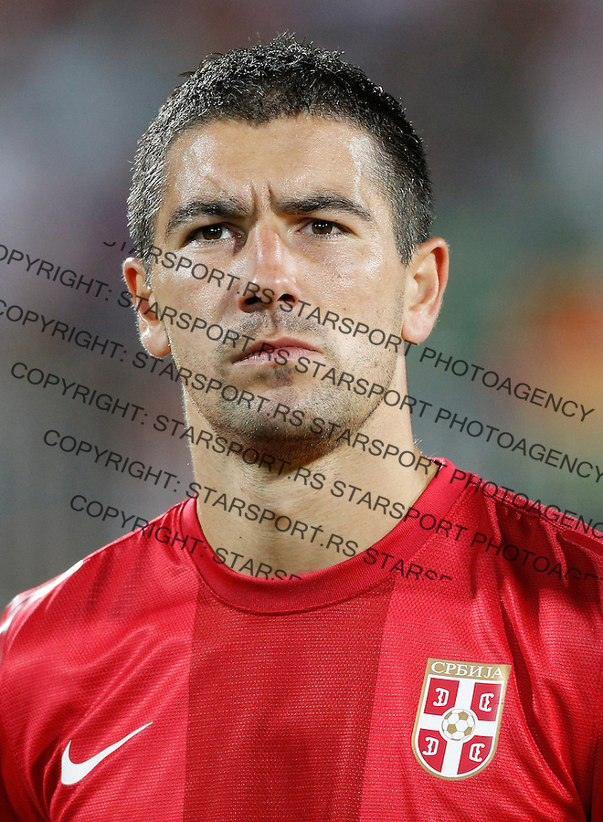 NOVI SAD, SERBIA - SEPTEMBER 11: Aleksandar Kolarov of Serbia listen national anthem prior the FIFA 2014 World Cup Qualifier at stadium Karadjordje Park between Serbia and Wales on September 11, 2012 in Novi Sad, Serbia (Photo by Srdjan Stevanovic/Getty Images)