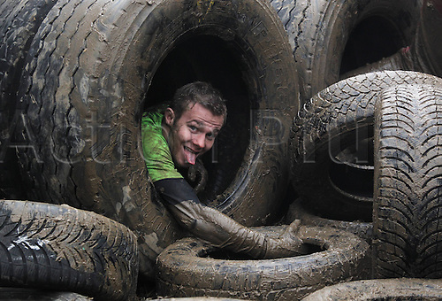 09.03.2013. Muennerstadt, Germany. Participants in the Braveheartbattle endurance race struggle along the race course during the 4th edition of the Braveheart-Battle sports event in Muennerstadt, Germany, 9 March 2013. Around 3.000 participants competed in the competition which includes diving through mud holes, artificial obstacles and freezing cold water.