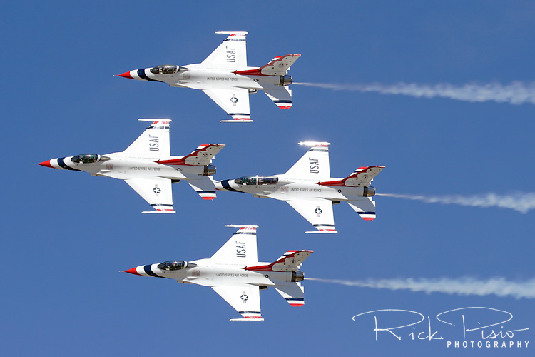 The United States Air Force Thunderbirds pass in front of the crowd line in Diamond Formation during the 2006 Reno National Championship Air Races at Stead Field in Nevada. The Thunderbirds were formed in 1956 and have been flying the F-16C Fighting Falcon since 1992. Photographed 09/06