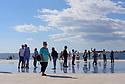Tourists on the Greeting to the Sun installation, Zadar, Croatia.