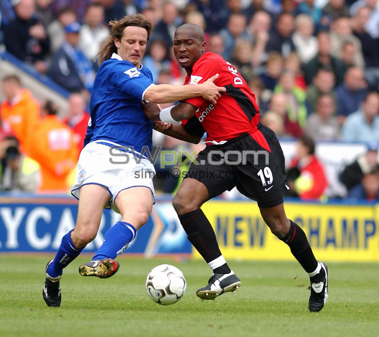 Pix:Daniel Hambury/SWpix.com. Premier League Football. Leicester v Manchester United... 27/09/03..COPYRIGHT PICTURE>>SIMONWILKINSON>>0870 092 0092>>..MACHESTER UNITED'S DJEMBA-DJEMBA AND LEICESTER CITY'S LILIAN NALIS