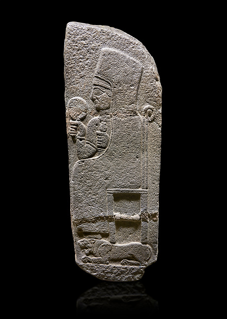 Hittite monumental relief sculpted orthostat stone panel of a Procession Basalt, Karkamıs, (Kargamıs), Carchemish (Karkemish), 900 - 700 B.C. Anatolian Civilisations Museum, Ankara, Turkey.<br /> <br /> Goddess Kubaba. End of pannels. The godess is saeted on a chair which is on a lion. she hold a mirror in her right hand and a pomegranate in her left.<br /> <br /> Against a black background.