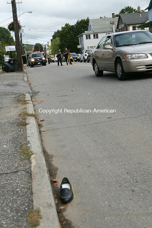 TORRINGTON, CT - 29 September, 2008 - 092908MO02 - Beatrice Colangelo, 76, was walking across Main Street when she was struck by this southbound Toyota Camry driven by fellow Torrington resident William Linden, 95. Colangelo, whose shoe is visible at the bottom left,  was flown to Hartford Hospital. Jim Moore Republican-American.