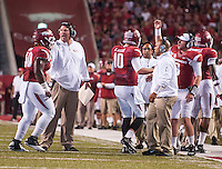 STAFF PHOTO ANTHONY REYES &bull; @NWATONYR<br /> Arkansas head coach Bret Bielema celebrates a touchdown with his players against Northern Illinois University in the third quarter Saturday, Sept. 20, 2014 at Razorback Stadium in Fayetteville. The Razorbacks won 52-14.