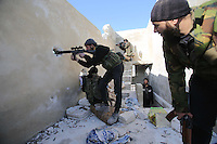 Photographer: Rick Findler/Borderline News..17.01.13 Soldiers belonging to the Free Syrian Army fire at Minnagh Military Airport. They are hoping to plan an offensive attack to take the airport from Assad control outside of Aleppo