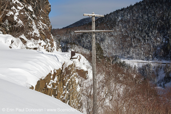 Old telephone pole along the Maine Central Railroad in Crawford Notch (Hart's Location), New Hampshire during the winter months. Dismal Pool is located down the steep embankment on the right.