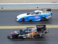 Jul 29, 2018; Sonoma, CA, USA; NHRA funny car driver Cruz Pedregon (near) races alongside Tommy Johnson Jr during the Sonoma Nationals at Sonoma Raceway. Mandatory Credit: Mark J. Rebilas-USA TODAY Sports