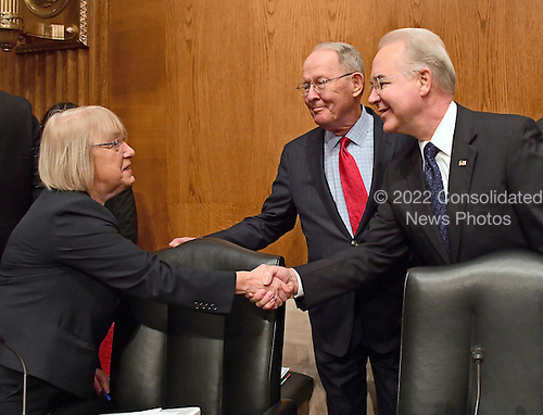 United States Representative Dr. Tom Price (Republican of Georgia), right, shakes hands with US Senator Patty Murray (Democrat of Washington), Ranking Member, US Senate Committee on Health, Education, Labor and Pension, left, as US Senator Lamar Alexander (Republican of Tennessee), Chairman, US Senate Committee on Health, Education, Labor and Pensions, center, looks on prior to giving testimony before the US Senate Committee on Health, Education, Labor and Pensions on his nomination to serve as US Secretary of Health and Human Services on Capitol Hill in Washington, DC on Wednesday, January 18, 2017.<br /> Credit: Ron Sachs / CNP