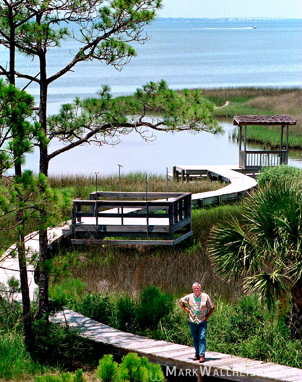 Songwriter and country music personality Tom T. Hall on the boardwalk to the Apalachicola Bay from his St. George Island home near Apalachicola, Florida June 25, 1996.