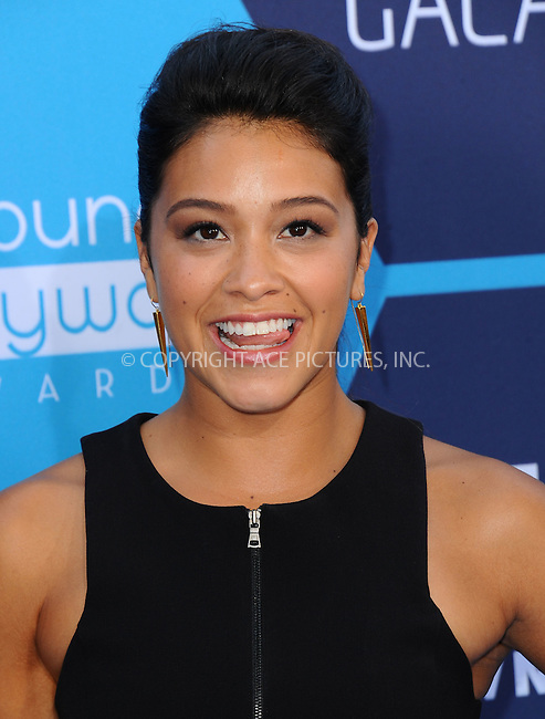 ACEPIXS.COM<br /> <br /> July 27 2014, LA<br /> <br /> Gina Rodriquez arriving at the 2014 Young Hollywood Awards at The Wiltern on July 27, 2014 in Los Angeles, California. <br /> <br /> By Line: Peter West/ACE Pictures<br /> <br /> ACE Pictures, Inc.<br /> www.acepixs.com<br /> Email: info@acepixs.com<br /> Tel: 646 769 0430