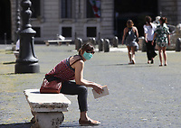 A girl reads a book in Piazza Navona in central Rome on May 4, 2020 as Italy starts to ease its lockdown, during the countrys lockdown aimed at curbing the spread of the COVID-19 infection, caused by the novel coronavirus.<br /> UPDATE IMAGES PRESS/Isabella Bonotto