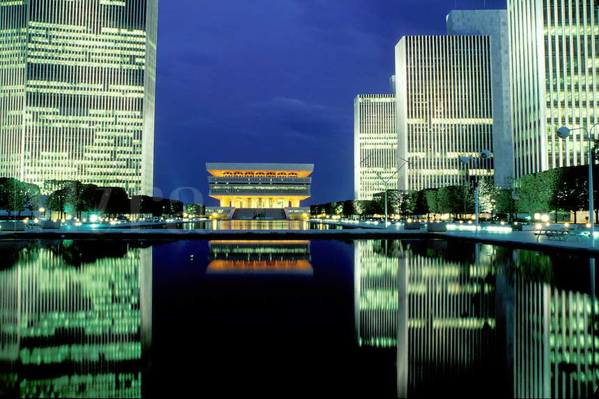 Albany, New York State Museum, New York, Reflection of the New York State Museum in the pool at the Governor Nelson A. Rockefeller Empire State Plaza illuminated at night in Albany, New York.