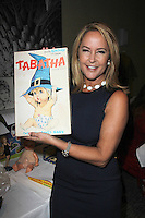 "Erin Murphy with vintage Tabatha paper dolls<br /> ""Bewitched"" Fan Fare Day 4, Sportsman's Lodge, Studio City, CA 09-20-14<br /> David Edwards/DailyCeleb.com 818-249-4998"