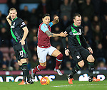 West Ham's Mauro Zarate tussles with Stoke's Glenn Whelan <br /> <br /> Barclays Premier League - West Ham United v Stoke City - Upton Park - England -12th December 2015 - Picture David Klein/Sportimage