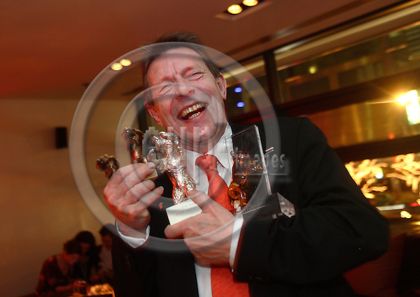 "BERLIN - GERMANY 18. FEBRUARY 2006 -- Berlin Filmfestival  -  Berlinale 2006   - At a party in Berlins Hotel Mandala  the director of the danish film institute (DFI) proudly display the evenings harvest of awards.  -- PHOTO: UFFE NOEJGAARD / EUP-IMAGES..This image is delivered according to terms set out in ""Terms - Prices & Terms"". (Please see www.eup-images.com for more details)."