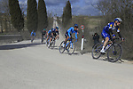The peloton including Dries Devenyns (BEL) Deceuninck-Quick Stepon sector 2 Bagnaia during Strade Bianche 2019 running 184km from Siena to Siena, held over the white gravel roads of Tuscany, Italy. 9th March 2019.<br /> Picture: Eoin Clarke | Cyclefile<br /> <br /> <br /> All photos usage must carry mandatory copyright credit (&copy; Cyclefile | Eoin Clarke)