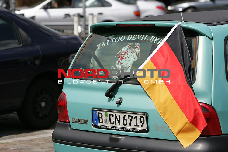 FIFA WM 2006 Germany - Feature<br /> German national flag on a car in Berlin during the world cup in Berlin.<br /> Foto &copy; nordphoto