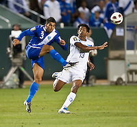 CARSON, CA – June 6, 2011: Guatemalan Cristian Jafeth Noriega (3) kicks the ball past Honduran Carlo Costly (13) during the match between Guatemala and Honduras at the Home Depot Center in Carson, California. Final score Guatemala 0, Honduras 0.