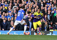 Pictured: Ashley Williams of Swansea (R) against Ross Barkley of Everton (L). Sunday 16 February 2014<br />