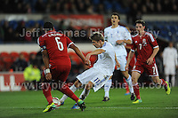 Ashley Williams of Wales attempts to prevent Riku Riski of Finland shooting for goal during the Wales v Finland Vauxhall International friendly football match at the Cardiff City stadium, Cardiff, Wales. Photographer - Jeff Thomas Photography. Mob 07837 386244. All use of pictures are chargeable.
