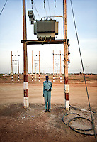 A policeman guards the power plant in Bentiu. South Sudan.