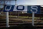 A home team banner on a crush barrier at the closed off Terregles Street terracing at Palmerston Park, Dumfries as Queen of the South hosted Dundee United in a Scottish Championship fixture. The home has played at the same ground since its formation in 1919. Queens won the match 3-0 watched by a crowd of 1,531 spectators.