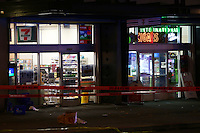 SEATTLE, WA - NOVEMBER 09: Police tape ropes off the sidewalk outside a 7-Eleven near Pine Street and 3rd Avenue on November 9, 2016 in Seattle, Washington.  Five people had been shot and sent to a hospital. (Photo by Karen Ducey/Getty Images)