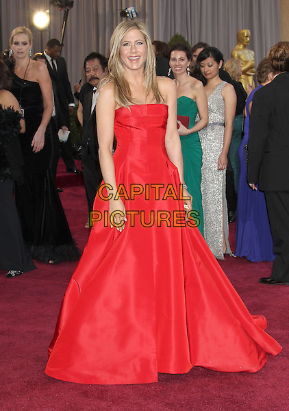 Jennifer Aniston (wearing Valentino).85th Annual Academy Awards held at the Dolby Theatre at Hollywood & Highland Center, Hollywood, California, USA..February 24th, 2013.oscars full length red strapless dress gown gold clutch bag .CAP/ADM/RE.©Russ Elliot/AdMedia/Capital Pictures.
