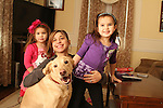 WATERBURY, CT-26 December 2013-122613LW01 - Carol Coffey, center, poses with her daughters, Peyton, 3, left, and Addison, 6, and their dog, Max. Max went missing for two weeks in August after he was hit by a car, but was reunited with his family. <br /> Laraine Weschler Republican-American