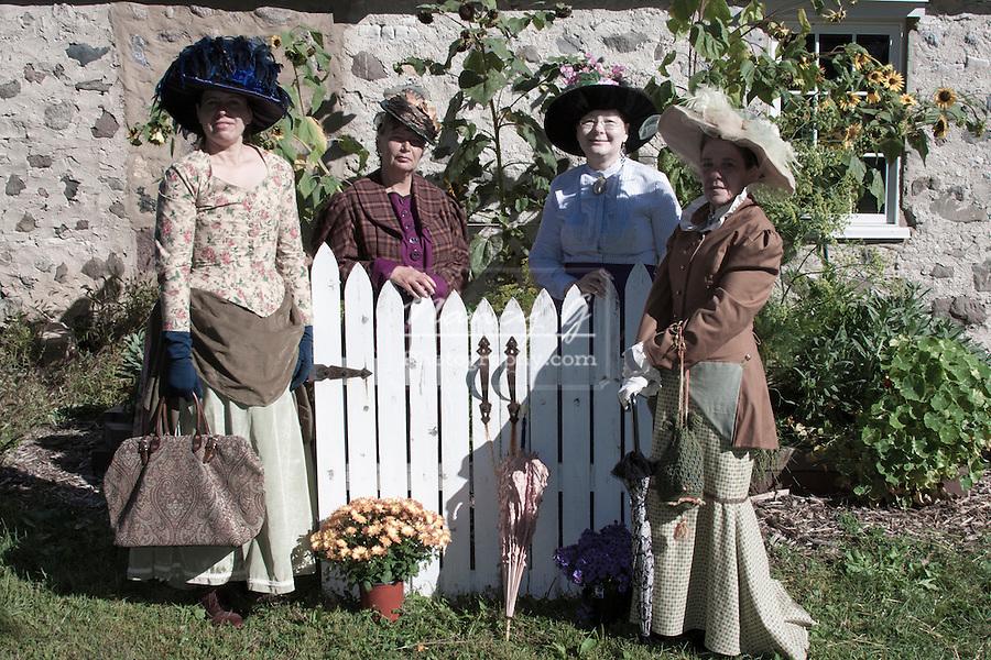 Four ladies posing in the summer garden