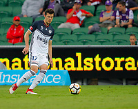 25th March 2018, nib Stadium, Perth, Australia; A League football, Perth Glory versus Melbourne Victory; James Donachie of Melbourne Victory passes the ball through midfield during the first half